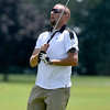 (Brad Davis/The Register-Herald) Eric Bishop reacts as he watches his shot from the fairway during BNI action Sunday morning at Grandview Golf Course.