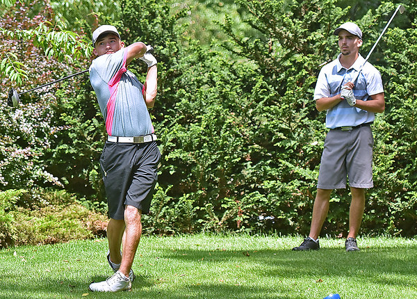 (Brad Davis/The Register-Herald) Cole Moore, right, waits his turn and watches as brother Cam tees off during BNI action Sunday morning at Brier Patch Golf Links.