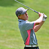(Brad Davis/The Register-Herald) Cam Moore watches his shot during BNI action Sunday morning at Brier Patch Golf Links.