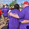 (Brad Davis/The Register-Herald) Cancer survivors embrace as they participate in a three-lap walk around the Beckley Intermodal Gateway to kick off the annual Relay For Life event by the American Cancer Society Friday evening. The first lap was made up of all survivors who were joined by caretakers during the second lap, who were then joined by anyone else who wished to walk with them during the third lap.