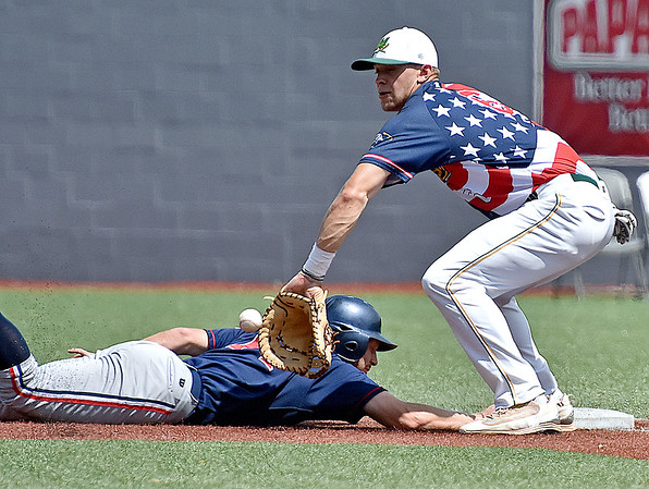 (Brad Davis/The Register-Herald) West Virginia first baseman Dan Ward reaches to catch a pickoff attempt as Chillicothe's Jack Thompson dives back safely during the Miners' 4-1 loss to the Paints Sunday afternoon at Linda K. Epling Stadium.