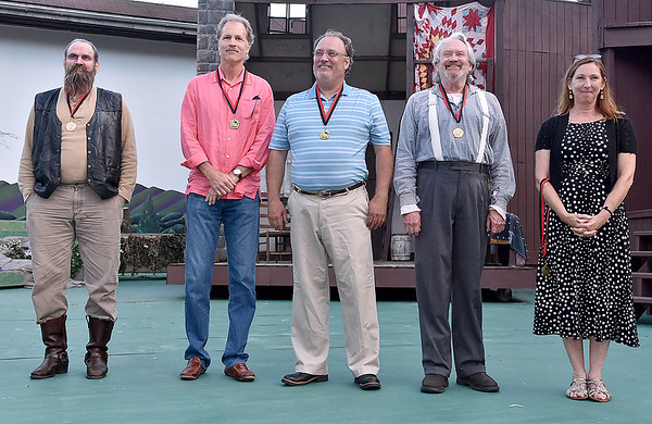 (Brad Davis/The Register-Herald) From left, Andy Woodruff, Mike Cavendish, Dan Henthorne, XXXX and Barbie Yurick accepting the medal on behalf of her late husband John Yurick Saturday evening at Grandviw Park's Cliffside Amphitheatre.