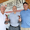 (Brad Davis/The Register-Herald) From left, Joel Davis Beckley Newspapers publisher Frank Wood and Tim Fitzwater during trophy presentations at the BNI Monday afternoon.