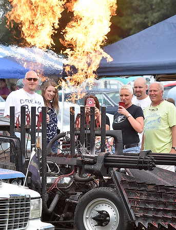 (Brad Davis/The Register-Herald) Attendees get a kick out flames that spew from the pipes of Nitro residents Greg and Sherry Fields' zombie hunter vehicle at the Friends of Coal Auto Fair Saturday afternoon at the Raleigh County Memorial Airport.
