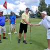 (Brad Davis/The Register-Herald) The foursome of (from left) John Barnhouse, Jeremy Carte, Boo Nuckols and Rob Howell shake hands and exchange pleasantries after finishing up a weekend of golf during BNI action Sunday afternoon at Grandview Golf Course. The top golfers after a round each at Grandview and Brier Patch Golf Links over the weekend compete for the tournament win today at Glade Springs' Cobb Course.