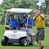 (Brad Davis/The Register-Herald) Rock Moyer, right, shoots from the fairway as groupmates George Barr, left, and Tom McGirl watch from their cart Sunday at Grandview.