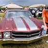 (Brad Davis/The Register-Herald) Fayetteville resident and car owner Steve Price, right, towels off his 1971 Chevelle with a little help from Anthony Salvatore following another brief rain shower at the Friends of Coal Auto Fair Saturday afternoon at the Raleigh County Memorial Airport.