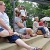 (Brad Davis/The Register-Herald) Fayetteville residents share a few laughs and spend time relaxing in front of the courthouse as they take in some live music during a community picnic Sunday afternoon. From left are Lisa Davis, Shondaya Fedotoff, Sage the dog accompanied by 13-year-olds Kat Rose (standing right) and Emily Mae (standing left), Sharon Snuffer, Kitty Hembrick, Doretha Rainey and Kim Richmond.