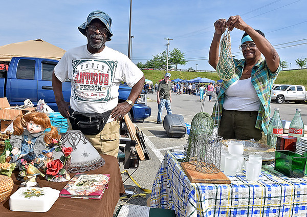 (Brad Davis/The Register-Herald) Queenester Jones and her husband Sylvester, who've attended the event almost every year since it started, man their tables during the 21st Annual Newspapers in Education Flea Market & Live Auction Saturday morning in the Marquee Cinemas parking lot.