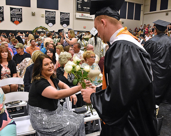 (Brad Davis/The Register-Herald) Graduating Westside seniors seek out any friends and family they can find who helped them in their journey during the flower ceremony prior to the school's 2016 commencement Sunday afternoon in Clear Fork.