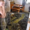 (Brad Davis/The Register-Herald) West Main Street resident Todd Schwear can only stare at the massive mess as he and his nine-year-old son Alex show the damage from Thursday night's flooding Saturday afternoon in Richwood.
