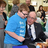 """(Brad Davis/The Register-Herald) Outgoing Wyoming County Schools Superintendent Frank """"Bucky"""" Blackwell is greeted by Pineville Elementary student Logan Wyatt, 9, during a retirement reception at Wyoming East High School Thursday evening."""