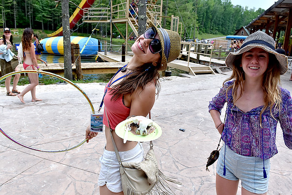 (Brad Davis/The Register-Herald) Fayetteville's Victoria Chesterfield, right, and Greensboro, North Carolina's Maria Ekaterina greeted fellow festival-goers with hugs during the final day of the Mountain Music Fest Saturday afternoon at Ace Adventure Resort.
