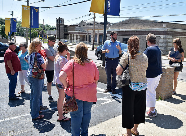 (Brad Davis/The Register-Herald) WVU Tech Resident Director Michael Sheldon (middle, facing camera) describes the facilities that will be available as he leads a tour group comprised of incoming students and their families around the campus Saturday morning along Kanawha Street.
