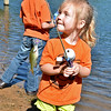 (Brad Davis/The Register-Herald) Proud three-year-old Ryleigh Farrish turns to show off a blue gill she pulled in as her big sister Destiny, 6, continues waiting for a bite during the annual Kid's Fishing Derby at Little Beaver State Park Saturday morning.