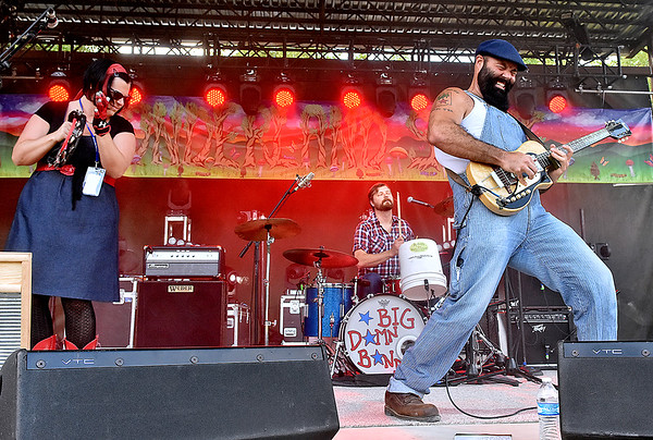 (Brad Davis/The Register-Herald) Reverend Peyton's Big Damn Band, consisting of (from left Breezy Peyton, drummer Ben Bussell and Reverend Peyton, perform as the weekend's first band to set foot on the main stage Friday evening at the Mountain Music Festival inside Ace Adventure Resort.