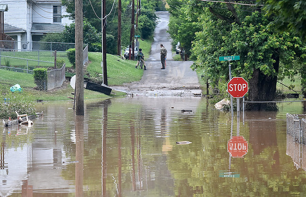 (Brad Davis/The Register-Herald) Parts of Alderson were still flooded early Friday evening.