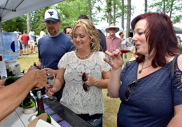 (Brad Davis/The Register-Herald) From left, Shady Spring residents Kevin and Sherri Sears, along with Mt. Hope resident Angela Criss, sample wines during Daniel Vineyards' annual Spring Wine Festival Saturday afternoon in Crab Orchard.