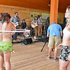 (Brad Davis/The Register-Herald) Festival-goers jam to Norfolk, Virginia's Major and the Monbacks as they perform on the Greenbrier Valley Brewing Company Lake Stage during the final day of the Mountain Music Festival Saturday afternoon at Ace Adventure Resort.