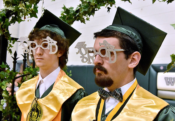 (Brad Davis/The Register-Herald) Graduating Wyoming East seniors enter the gym Sunday afternoon in New Richmond.