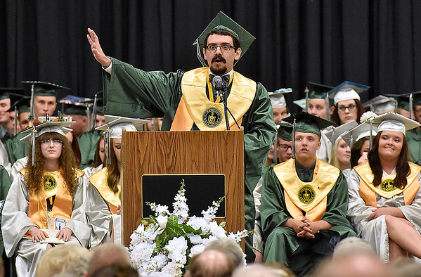 (Brad Davis/The Register-Herald) Bradley McKinney speaks as Salutatorian during Wyoming East High 2016 commencement ceremony Sunday afternoon in New Richmond.