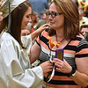 (Brad Davis/The Register-Herald) Graduating Wyoming East seniors seek out any friends and family they can find who helped them in their journey during the flower ceremony prior to the school's 2016 commencement Sunday afternoon in New Richmond.