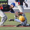 (Brad Davis/The Register-Herald) West Virginia's Austin Norman is caught trying to steal second after against Champion City Sunday afternoon at Linda K. Epling Stadium.