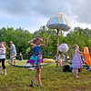 (Brad Davis/The Register-Herald) Youngsters pass the time Friday evening at Mountian Music Festival.