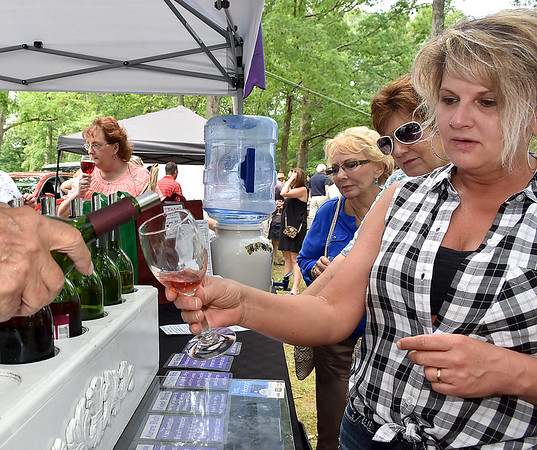 (Brad Davis/The Register-Herald) Crab Orchard resident Kerrie Lilly samples different flavors during Daniel Vineyards' annual Spring Wine Festival Saturday afternoon in Crab Orchard.