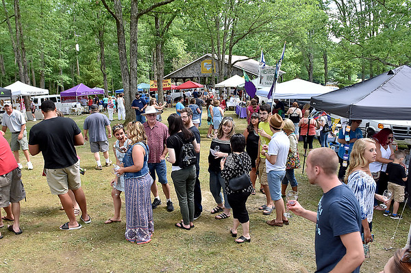 (Brad Davis/The Register-Herald) Long lines for samples were a common occurrence during Daniel Vineyards' annual Spring Wine Festival Saturday afternoon in Crab Orchard.