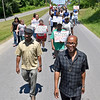 (Brad Davis/The Register-Herald) Community members and congregants from the Welcome Baptist Church on 8th street walk down Powerline Drive as they take part in a march for safe streets Saturday afternoon in Beckley. The annual march, led this year by pastor David Allen (bottom right), the march isn't a protest against any person, thing or issue, but a show solidarity with those who wish and strive for a safe community.