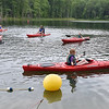 (Brad Davis/The Register-Herald) A group of girl scouts from the Morgantown and Chicago areas paddle around in canoes as they learn new skills from instructor Paul Abel, upper middle, during the last day of an event at the Bechtel Summit Reserve Friday afternoon.