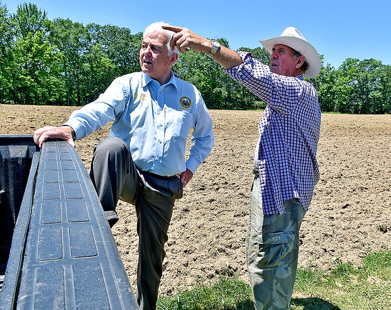 (Brad Davis/The Register-Herald) Property owner Frank Lilly talks with Walt Helmick during a Register-Herald visit to the historic farm June 8.