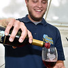 (Brad Davis/The Register-Herald) Chad Daniels, grandson of vineyard owner C. Richard Daniel and a first year wine maker himself, pours a glass of his family's finest during Daniel Vineyards' annual Spring Wine Festival Saturday afternoon in Crab Orchard.