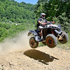 (Brad Davis/The Register-Herald) Beckley resident Dan Lilly catches some air, something you don't necessarily want to do to post a fast time, off the edge of the first level on his way up the steep hill-climb track during Thrills in the Hills Saturday morning at Burning Rock Outdoor Adventure Park.