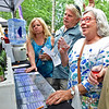 (Brad Davis/The Register-Herald) Lewisburg resident Wanda Dolan, right, enjoys a sample from Moorefield, WV based West-Whitehill Winery during Daniel Vineyards' annual Spring Wine Festival Saturday afternoon in Crab Orchard.