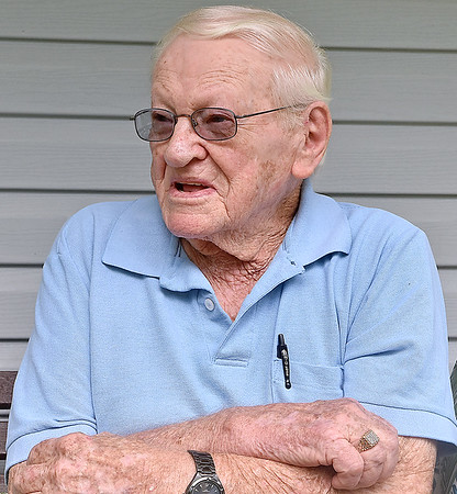 (Brad Davis/The Register-Herald) 94-year-old World War II veteran Jesse Terry discusses his experiences during the war and working at a coal mine after returning during a Register-Herald visit to his Midway home near Crab Orchard Thursday afternoon.