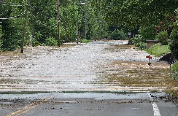 (Brad Davis/The Register-Herald) Greenbrier Drive in Hinton was still well underwater Friday.