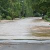 (Brad Davis/The Register-Herald) Greenbrier Drive in Hinton was still well underwater Friday.