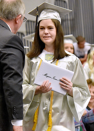 (Brad Davis/The Register-Herald) Graduating Westside senior Morgan Akers accepts her diploma during the school's 2016 commencement ceremony Sunday afternoon in Clear Fork.