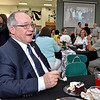 "(Brad Davis/The Register-Herald) Outgoing Wyoming County Schools Superintendent Frank ""Bucky"" Blackwell turns and has a few laughs as he watches and reacts to a slideshow with hundreds of photos from his life and career in the region during a retirement reception at Wyoming East High School Thursday evening. Blackwell served Wyoming County for 34 years, the longest serving superintendent in West Virginia history. Thursday also happened to be his birthday."