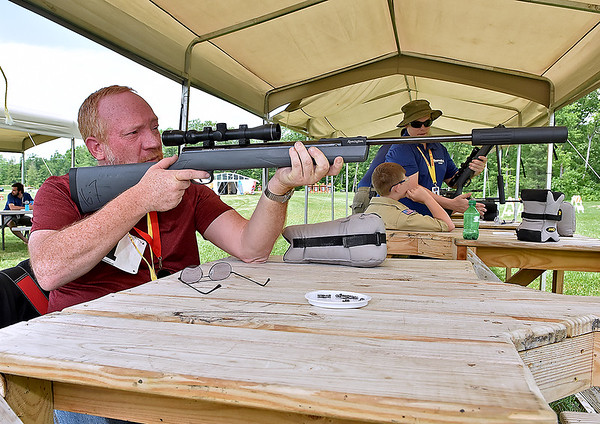 (Brad Davis/The Register-Herald) Cross Lanes resident and former serviceman Brooks Martin takes shots at the pellet rifle range as he participates in a Boy Scouts of America Veterans Appreciation Day event at the Summit Bechtel Reserve Saturday afternoon near Glen Jean.