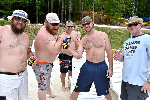 "(Brad Davis/The Register-Herald) Proud West Virginians (from left) John Pitt, Scott ""Chunk"" Miller, Bruce Hiser, Dale Kleeh and a guy who called himself Moon Dog pose for a quick photo during the final day of the Mountain Music Fest Saturday afternoon at Ace Adventure Resort."