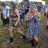 (Brad Davis/The Register-Herald) A muddy main stage viewing area didn't stop music lovers from grooving as Reverend Peyton's Big Damn Band performed Friday evening inside Ace Adventure Resort.
