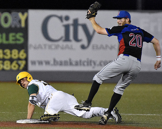 (Brad Davis/The Register-Herald) West Virginia's Ryan Perkins steals second after knocking in the tying run against Champion City Saturday night at Linda K. Epling Stadium.