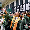 (Brad Davis/The Register-Herald) Graduating Wyoming East seniors begin tossing their caps into the air as the school's 2016 commencement ceremony comes to an end Sunday afternoon in New Richmond.
