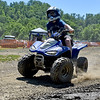 (Brad Davis/The Register-Herald) Nine-year-old Antonio Bartoli hangs on tight as he speeds through a turn while tearing around a small dirt track on his four-wheeler during Thrills in the Hills Saturday morning at Burning Rock Outdoor Adventure Park.