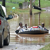 (Brad Davis/The Register-Herald) Parts of Alderson were still flooded early Friday evening.