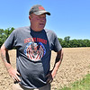(Brad Davis/The Register-Herald) Steve Powers describes the potato growing program during a Register-Herald trip to the historic farm near Jumping Branch June 8.