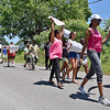 (Brad Davis/The Register-Herald) Community members and congregants from the Welcome Baptist Church on 8th street walk down Powerline Drive as they take part in a march for safe streets Saturday afternoon in Beckley. The annual march, led this year by pastor David Allen, the march isn't a protest against any person, thing or issue, but a show solidarity with those who wish and strive for a safe community.